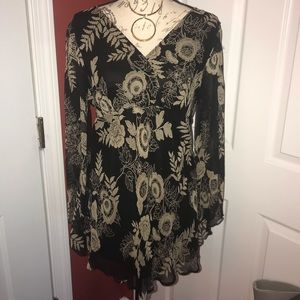 Beige n Black blouse. Is lined with silk shell